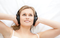 Attractive woman listening to music Stock Images