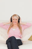 Attractive woman listening to music Stock Photo
