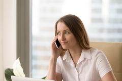 Attractive woman listening voice mail messages Stock Photography