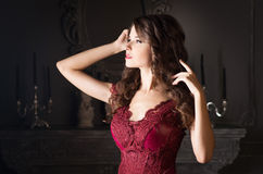 Attractive woman in long claret lace dress Stock Photos