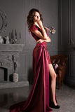 Attractive woman in long claret lace dress Royalty Free Stock Photo
