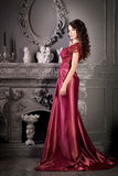 Attractive woman in long claret lace dress Royalty Free Stock Photos
