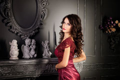 Attractive woman in long claret lace dress Stock Photography