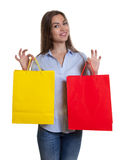 Attractive woman with long dark hair and shopping bags Stock Photography