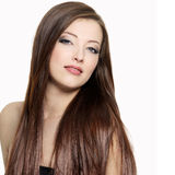Attractive woman with  long gloss hair Royalty Free Stock Photos