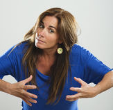 Attractive woman with long hair and blue shirt very angry Stock Images