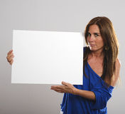 Attractive woman with long hair holding a white sign Royalty Free Stock Images