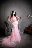 Attractive woman in long pink dress. Luxury Royalty Free Stock Image