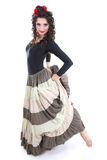 Attractive woman in long skirt dancing Stock Photography