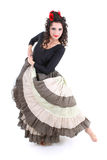 Attractive woman in long skirt dancing Stock Photo