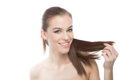 Attractive woman with long smooth hair Royalty Free Stock Photography