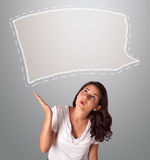 Attractive woman looking abstract speech bubble copy space. Attractive young woman looking abstract speech bubble copy space Royalty Free Stock Photos