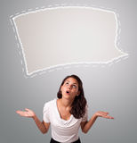 Attractive woman looking abstract speech bubble copy space. Attractive young woman looking abstract speech bubble copy space Stock Photos