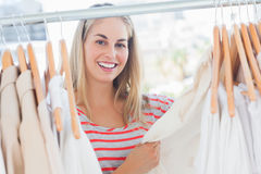 Attractive woman looking at clothes Royalty Free Stock Photography