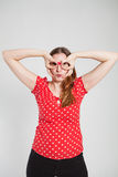 Attractive woman looking through finger goggles Royalty Free Stock Photo