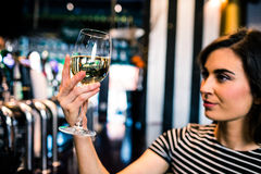 Attractive woman looking at her glass of wine Royalty Free Stock Images
