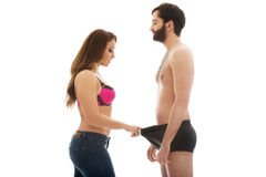 Attractive woman looking into man's panties. Royalty Free Stock Photography