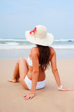 Attractive woman looking at the ocean Stock Images