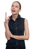 Attractive woman looking and pointing up. Isolated on white Royalty Free Stock Photography