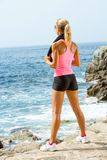 Attractive woman looking at sea after exercise. Stock Photography