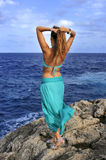 Attractive woman looking at sea horizon thoughtful from rock cliff  in relax concept Royalty Free Stock Images