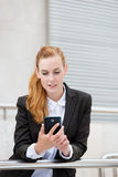 Attractive Woman Looking At Smartphone Stock Photos