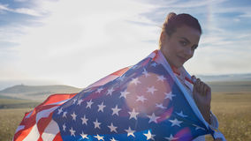Attractive woman looking to camera wearing a US flag Stock Photos