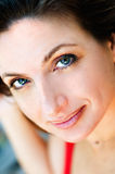 Attractive woman looking up. Tightly cropped portrait of an attractive woman with a flawless complexion, looking up Royalty Free Stock Images
