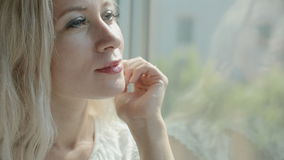 Attractive woman looking in the window of the train stock video footage