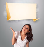 Attractive woman lookint modern origami copy space Stock Photography