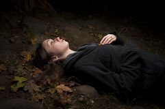 Attractive woman lying in autumn Royalty Free Stock Images