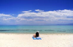 Attractive woman lying on the beach Royalty Free Stock Photos