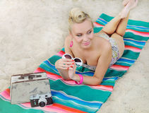 Attractive woman lying on the beach with vintage colorful detail Royalty Free Stock Images