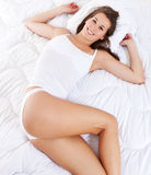Attractive woman lying in bed Stock Photography