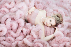 Attractive woman lying on the floor in pink cloud dress. Fashion Royalty Free Stock Photography