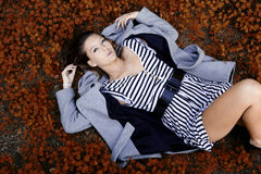 Attractive woman lying on the ground Royalty Free Stock Images