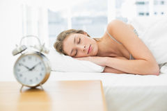 Attractive woman lying in her bed sleeping Royalty Free Stock Photos