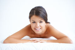 Attractive woman lying on her stomach Royalty Free Stock Image