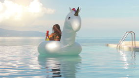 Attractive woman lying on Inflatable unicorn in swimming pool. On sea background stock video footage