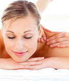 Attractive woman lying on a massage table Stock Image