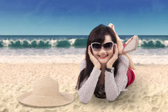 Attractive woman lying on the seaside 1 Stock Photos