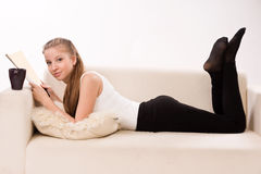 Attractive woman lying on a sofa Stock Photo