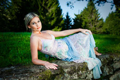 Attractive woman lying on stones Royalty Free Stock Photo