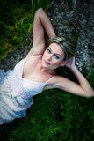 Attractive woman lying on stones Royalty Free Stock Images