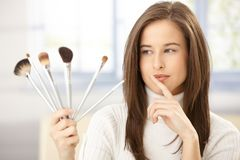 Attractive woman with makeup brush Royalty Free Stock Images