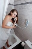 Attractive woman making call in bathroom Royalty Free Stock Photo