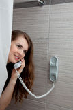 Attractive woman making call in bathroom Royalty Free Stock Photos