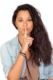 Attractive woman making a gesture of silence. Isolated on a over white background Royalty Free Stock Photo