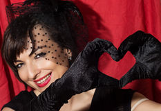 Attractive woman making heart shape with her hands Royalty Free Stock Images
