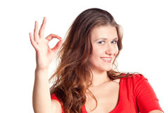 Attractive Woman Making 'OK' Hand Gesture Stock Image